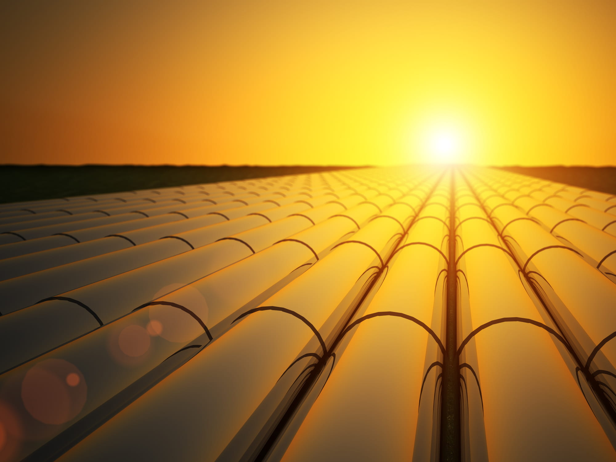 Gas pipelines at sunset
